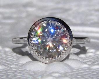 Forever One Moissanite Engagement Ring with White Gold Milgrain Bezel