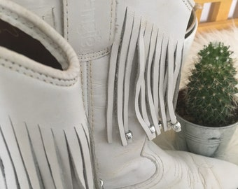 Vintage white leather cowboy western boots with tassels