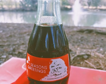 """RARE """"Seasons Greetings"""" Coca-Cola Bottle Never Opened!  (Red bag included)"""