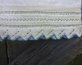 Pair of vintage pillowcases with blue and white knit lace