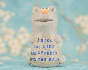 I miss you like the deserts miss the rain. Gray cat Figurine.