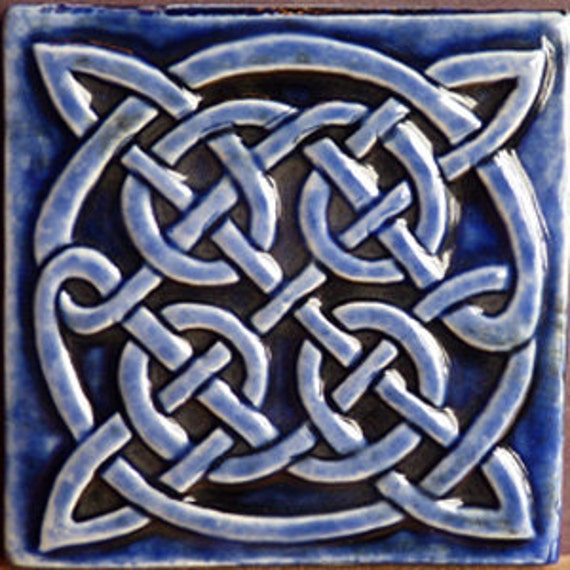 Decorative relief carved ceramic Celtic knot tile