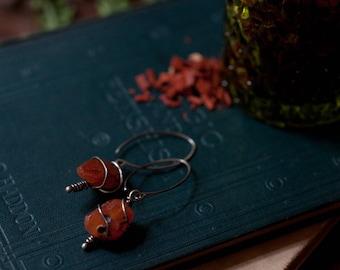 Rough carnelian nugget and sterling silver earrings, raw gemstone earrings, wire wrapped carnelian, burnt orange gemstone earrings.