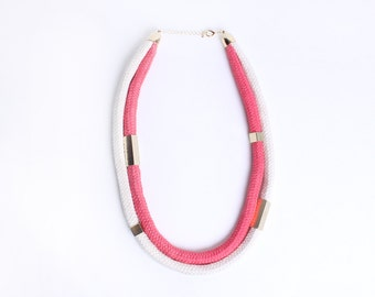 Cord necklace in coral and creme with beads