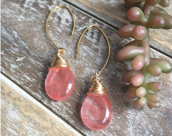 Handcrafted gemstone earrings .