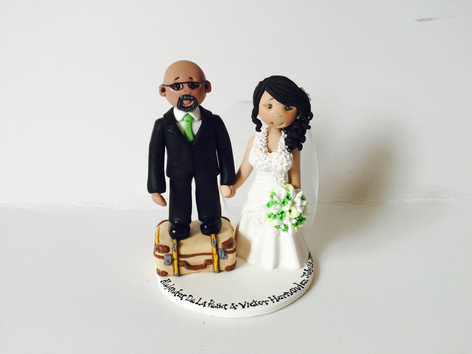Short groom and tall bride personalised wedding cake topper