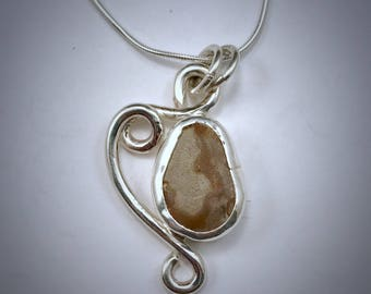 Sterling silver Piece of Maine necklace with a brown and tan beach stone necklace with swirls of silver