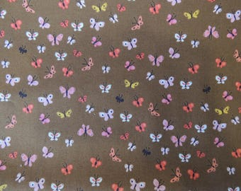Fabric Patchwork background Brown ochre multicolored butterflies