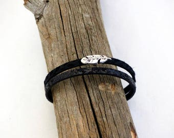 Natural leather strap and fancy feather