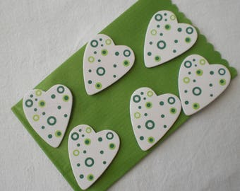 Six little decorated wooden hearts