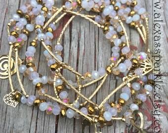 White and gold bracelets with gold plated charms - Semanario color blanco y oro con dijes de chapa de oro