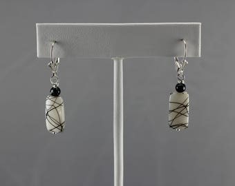 White with black paint splatter shell earrings