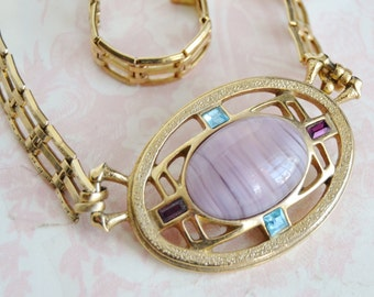 Vintage Necklace in Gold Tone Metal with Purple Glass Adorned Pendant