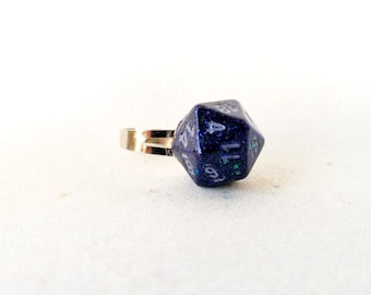 Individually cast clear resin D20 dice ring with black and dark purple glitter