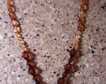 "29 off white and brown spotted shell with clear brown bead 27"" necklace"
