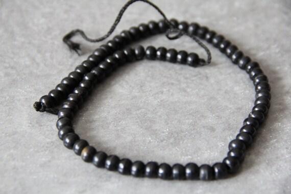 """Black Horn 8x6mm roundel beads,  18"""" long full strand"""