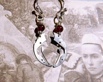 Garnet Earrings and watch parts.