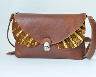 Brown leather bag with yellow silk screenprint