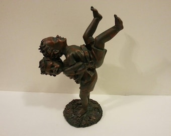 Figurine of Kids Having Fun