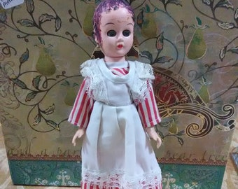 Vintage Madam Alexander doll. Brown hair and  hazel eyes.