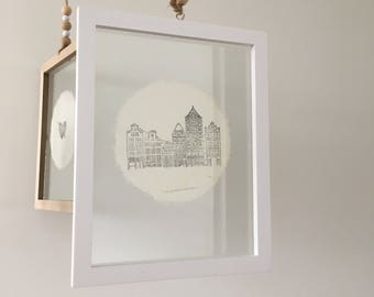 Double glass frame with handmade paper and dutch canal houses illustration