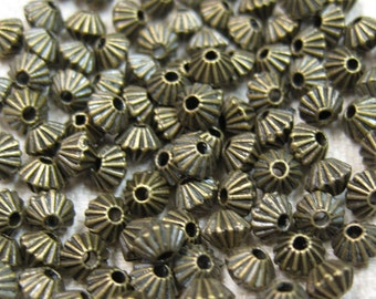 50 Corrugated Antique Bronze Bicone Spacer Beads 5mm x 4mm F319B
