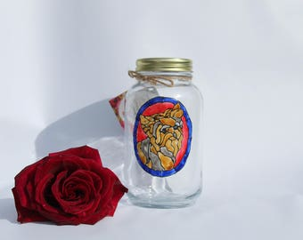 handmade yorkie dog portrait on glass jar with a stained glass look.