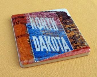 Coasters North Dakota painting on building