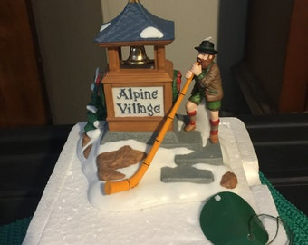 Dept 56 Heritage Village - Alpenhorn Player with Alpine Village Sign - Alpine Village
