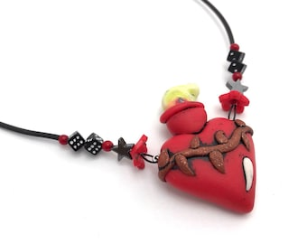 Little Lucky Sacred heart necklace, short necklace with dice and flowers, hemitite stars, flames and a crown of thorns by Marie Segal 2010