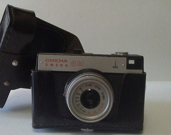 This is an old Russian camera Smena 8 m with original black leather cover.