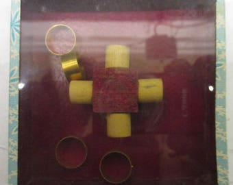 antique dexterity game puzzle with four rings