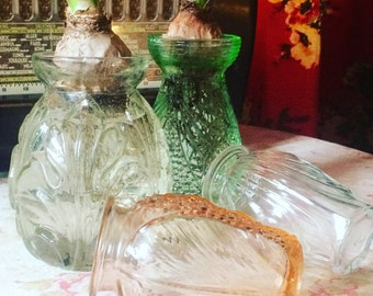 Vases hyacinth or bulb glass shakers. 1930 s 3 different colors. Depression glass.