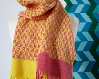 Colourful patterned knitted 'Units' scarf in pink and yellow lambswool. Fringed scarf with triangles, geometric, handmade, fair isle