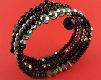 Black Memory Wire Bangle - Stacked beaded coils bracelet with mixed beads in black with touches of silver - boho gypsy wrap around layered