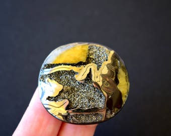 40 x 37 x 7 mm  Rare Simbircite-ammonite with silver pyrite  cabochon