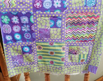 Quilt top lap or baby featuring Kaffe Fassett collective fabrics in greens and lavenders 58.5 x 45 inches