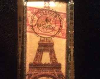 Mother's Day Gift: Decoupage Eiffel Tower and canceled postage in a pendant necklace