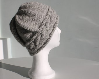Hand knit beanie hat with big cable light grey