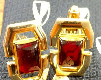 Vintage gold tone cufflinks with red stone.