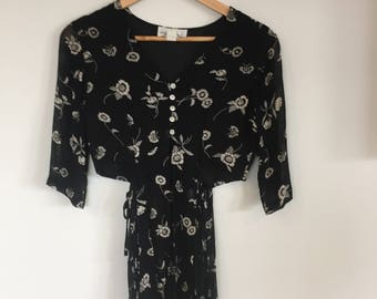 Navy/Black and white floral top. Button up top with sheer bottom half. FESTIVAL top. Marked size 12.