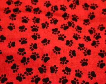 23 Red paws cotton. Great for quilts with a doggy theme and more