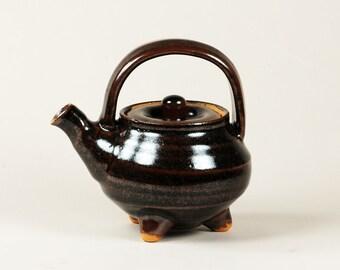 Personal 1 3/4 cup teapot on three feet, Tenmoku glaze