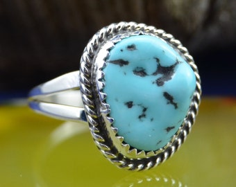Sterling silver ladies ring with one free form white water turquoise stone size 7.5