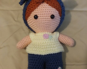 Red haired WeeBee doll with blue headband