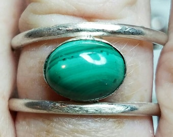 Sterling silver and malachite adjustable ring.