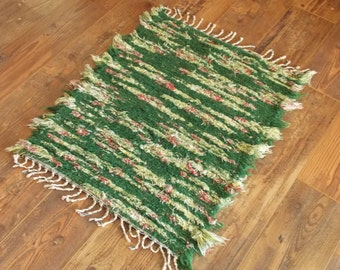 Green and yellow woven rug