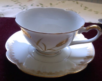 T & V Limoges Wheat Gold and White Cup and Saucer from France