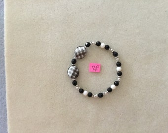 "7 & 1/4"" Black and White Stretch Cord Bracelet."
