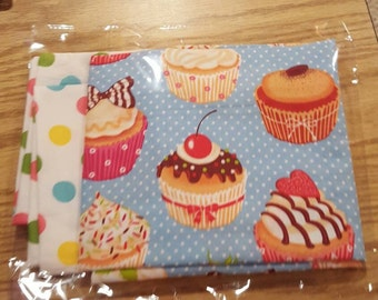 Cupcake themed standard pillowcase with pastel polka-dot band accent.